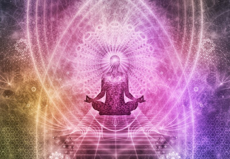 Abstract image of person meditating with pink and orange psychedelic elements
